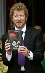 Sebastian Faulks holding Devil May Care