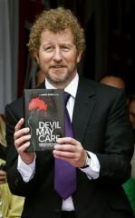 Sebastian Faulks holding Devil May Care